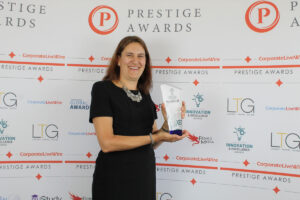 Deb Harrison with award for best web design 2021